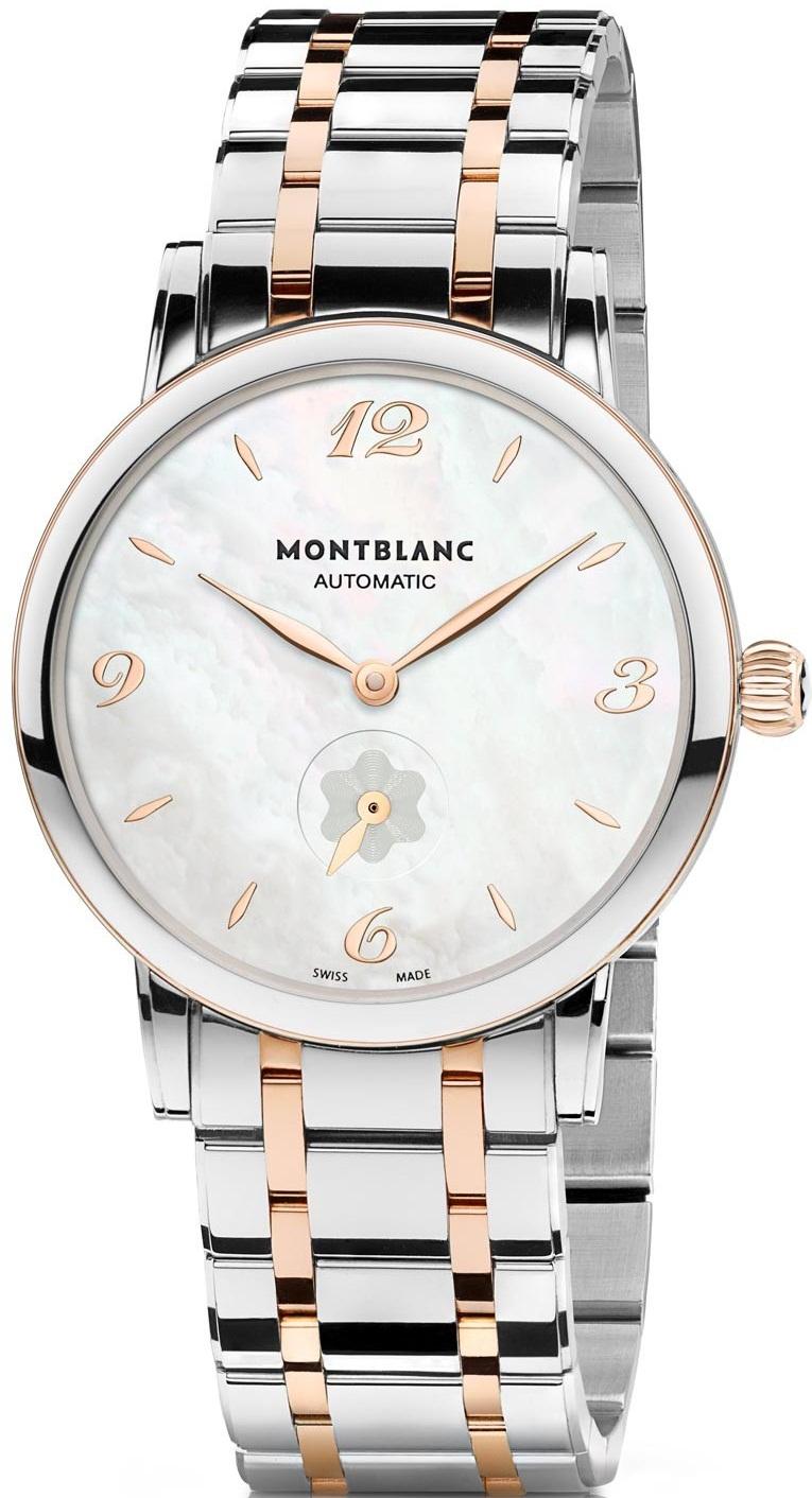 Montblanc Star 107913Наручные часы<br>Швейцарские часыMontblanc Star Classique Lady Automatic 107913Модель отличается совершенной, лаконичной и утонченной формой. Изысканные нюансы отделки ложатся в основу благородного классического стиля, ставшего идеальным воплощением элегантной экстравагантности. Часы Star Classique Lady Automatic с необычайно тонким корпусом отличаются минималистской индикацией времени и непревзойденным уровнем швейцарского часового мастерства. Идеальная точность хода сочетается со стильным силуэтом корпуса диаметром 34 мм с вставкой из 18К золота по безелю, свидетельствующем об изысканном вкусе и безупречном стиле своей владелицы.<br><br>Пол: Женские<br>Страна-производитель: Швейцария<br>Механизм: Механический<br>Материал корпуса: Сталь+Золото<br>Материал ремня/браслета: Сталь+Золото<br>Водозащита, диапазон: 20 - 100 м<br>Стекло: Сапфировое<br>Толщина корпуса: 9 мм<br>Стиль: Классика